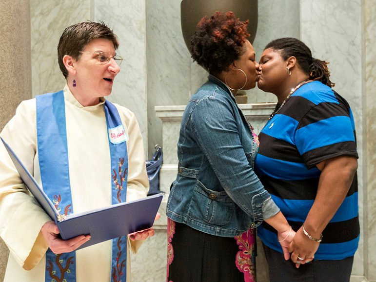 The Rev. Jennie Barrington, left, performs the marriage ceremony of Amanda Boyd and Narkisha Scott at the Pulaski County Courthouse in Little Rock, Ark., on May 12, 2014. Photo courtesy of REUTERS/Jacob Slaton