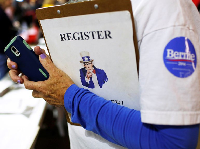 A volunteer staffs a voter registration table before U.S. Democratic presidential candidate Bernie Sanders held a campaign rally in New Brunswick, N.J., on May 8, 2016.  Photo courtesy of REUTERS/Dominick Reuter *Editors: This photo may only be republished with RNS-VOTER-REGISTRATION, originally transmitted on August 3, 2016.