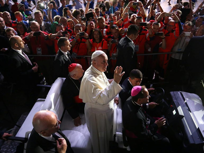 Pope Francis waves at the World Youth Day volunteers and organizers at Tauron Arena in Krakow, Poland, on July 31, 2016. Photo courtesy of Agencja Gazeta/Jakub Porzycki/via REUTERS  *Editors: This photo may only be republished with RNS-WOMEN-DEACONS, originally transmitted on August 2, 2016.