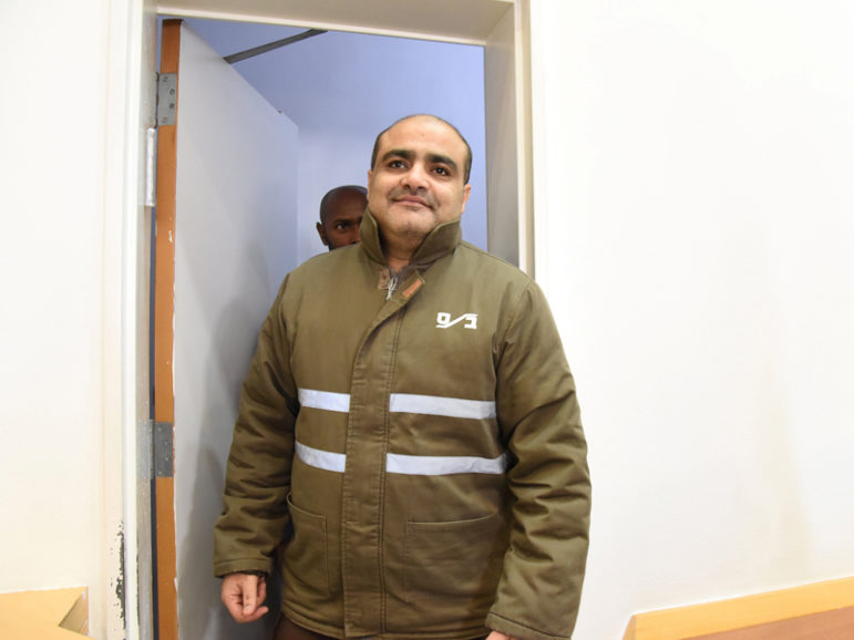 Palestinian Mohammad El Halabi, front, a manager of operations in the Gaza Strip for U.S.-based Christian charity World Vision, is seen before a hearing at the Beersheba district court in southern Israel on Aug. 4, 2016. Halabi is accused by Israel of funneling millions of dollars in aid money to Hamas in Gaza, a charge denied by the Islamist militant group. Photo courtesy of REUTERS/Dudu Grunshpan *Editors: This photo may only be republished with RNS-WORLDVISION-HAMAS, originally transmitted on Aug. 4, 2016.