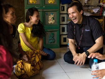 """Compassion International President Santiago """"Jimmy"""" Mellado visits with people during a trip to Indonesia on April 12, 2014. Photo courtesy of Compassion International"""