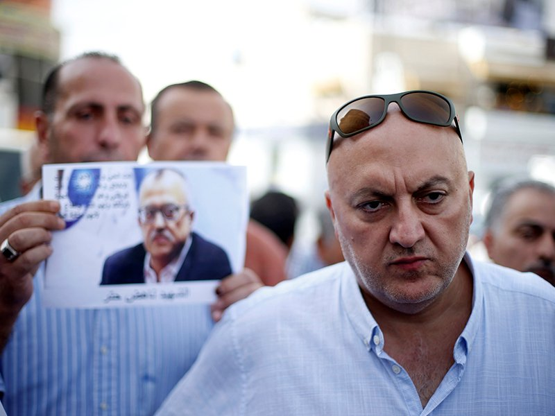 Majed Hattar, brother of the Jordanian writer Nahed Hattar, speaks to the media during a sit-in in town of Al-Fuheis