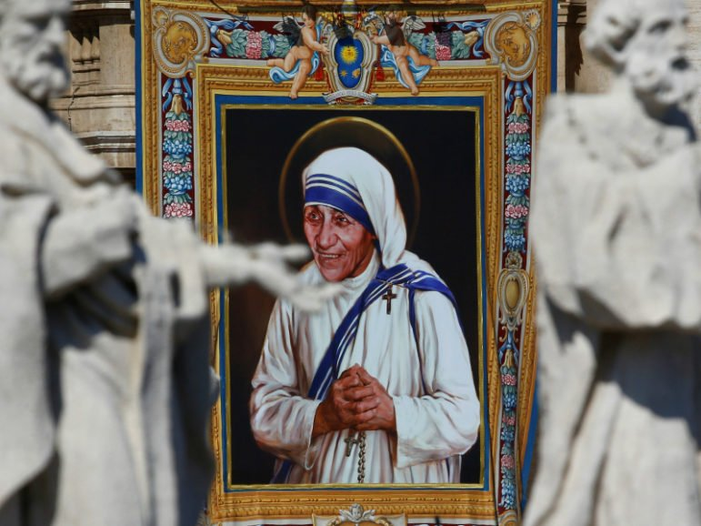 A tapestry depicting Mother Teresa of Calcutta is seen in the facade of Saint Peter's Basilica during a Mass, celebrated by Pope Francis, for her canonization in Saint Peter's Square at the Vatican September 4, 2016. Photo via Reuters/Stefano Rellandini