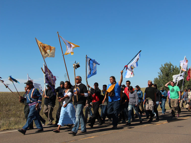 Several hundred people took part in a prayer walk on Sept. 14, 2016, from the Oceti Sakowin camp near Standing Rock Reservation in North Dakota to the site up the road where Dakota Access began digging over Labor Day weekend for construction on a nearly 1,200-mile pipeline project. RNS photo by Emily McFarlan Miller