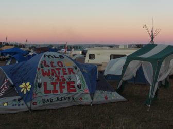 Tepees and tents line the North Dakota plains on Sept. 13, 2016, at the Oceti Sakowin camp near the Standing Rock Reservation in North Dakota. An estimated 7,000 people gathered there in solidarity with the Standing Rock Sioux Tribe in opposition to the Dakota Access pipeline project, reportedly the largest gathering of Native Americans in more than a century. RNS photo by Emily McFarlan Miller