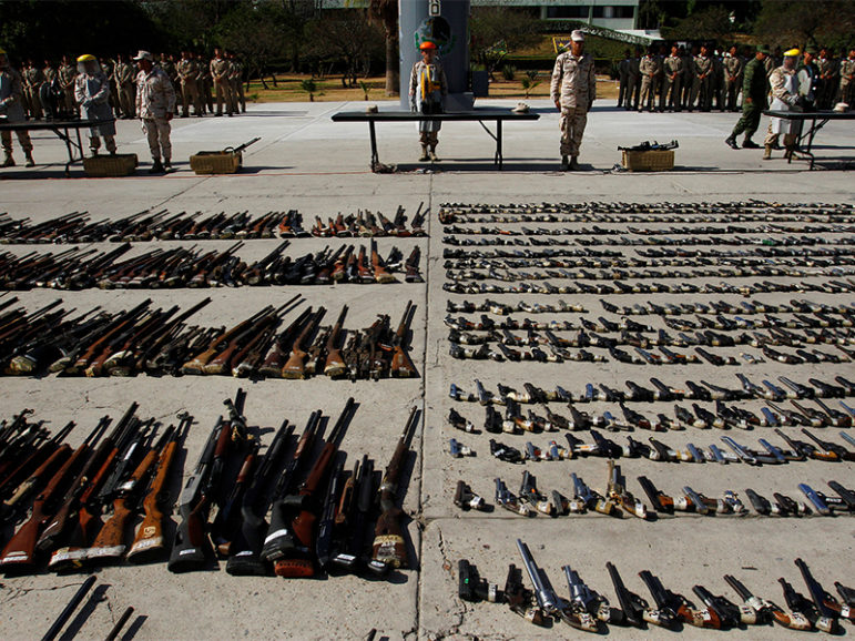 Weapons seized from criminal gangs are displayed before being destroyed by military personnel at a military base in Tijuana, Mexico, on August 12, 2016. Photo courtesy of REUTERS/Jorge Duenes