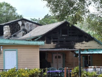 Fire-charred roofs of buildings at the Islamic Center of Fort Pierce on Midway Road are seen hours after the mosque was set on fire in an arson attack on Sept. 12, 2016, in White City, Fla. Photo courtesy of Eric Hasert, The (Stuart, Fla.) News