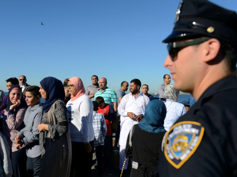 A member of the New York City Police Department stands guard during a group prayer session for the Muslim holiday Eid al-Adha in the Brooklyn borough of New York City on Aug. 12, 2016. Photo courtesy of Reuters/Stephanie Keith