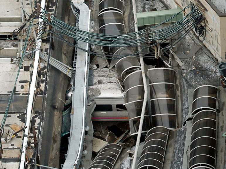 A derailed New Jersey Transit train is seen under a collapsed roof after it derailed and crashed into the station in Hoboken, NJ, on Sept. 29, 2016.    Photo courtesy of REUTERS/Carlo Allegri