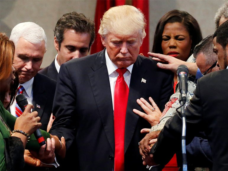 Members of the clergy lay hands and pray over Republican presidential nominee Donald Trump at the New Spirit Revival Center in Cleveland Heights, Ohio, on Sept. 21, 2016. Photo courtesy of REUTERS/Jonathan Ernst *Editors: This photo may only be republished with RNS-WAX-ANALYSIS, originally transmitted on Sept. 26, 2016.