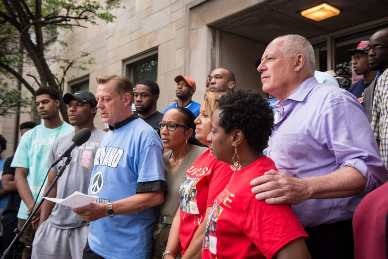 Father Michael Pfleger of St. Sabina Church is joined by Governor Pat Quinn in a march to stand against gun violence on Chicago's South Side. July 11, 2014. | Photo credit: Christopher Dilts for Quinn for Illinois (CC)