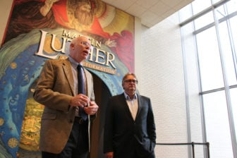 "Tom Rassieur, the John E. Andrus III Curator of Prints at the Minneapolis Institute of Art, and Harald Meller, director and state archeologist at the State Office for Heritage Management and Archaeology Saxony-Anhalt and State Museum of Prehistory in Halle, Germany, speak to the press Oct. 27, 2016, outside the exhibition ""Martin Luther: Art and the Reformation"" at the Minneapolis Institute of Art in Minneapolis. RNS photo by Emily McFarlan Miller"