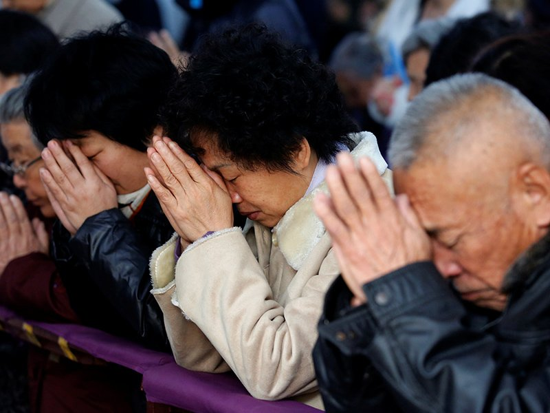 Believers take part in a weekend mass at an underground Catholic church in Tianjin