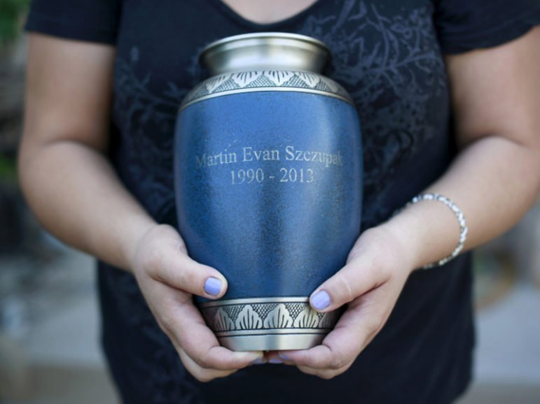 Inez Szczupak holds an urn filled with the ashes of her son Martin, who died of a drug overdose, outside her home in the Staten Island borough of New York on Aug. 19, 2015.Photo courtesy of REUTERS/Shannon Stapleton *Editors: This photo may only be republished with RNS-VATICAN-CREMATION, originally transmitted on Oct. 25, 2016.