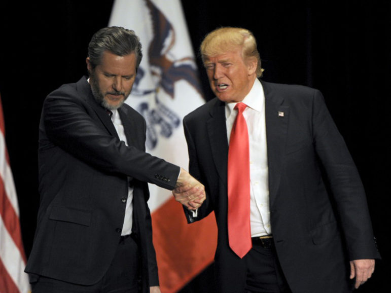 Republican presidential candidate Donald Trump, right, shakes hands with co-headliner Jerry Falwell Jr., leader of the nation's largest Christian university, during a campaign event at the Orpheum Theatre in Sioux City, Iowa, on Jan. 31, 2016. Photo courtesy of Reuters/Dave Kaup