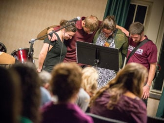 Students pray during an InterVarsity gathering at Roanoke College in Salem, Va.