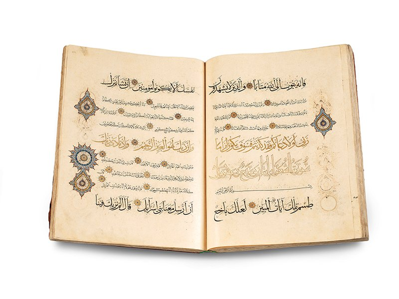 A single -volume Quran attributed to the calligrapher Abdallah al –Sayrafi, copied in what is now Iran, probably around 1330 CE. The ink, color, and gold on paper manuscript is from the Museum of Turkish and Islamic Arts in Istanbul and is now on display at the Smithsonian's Arthur M. Sackler Gallery. Photo courtesy of the Smithsonian