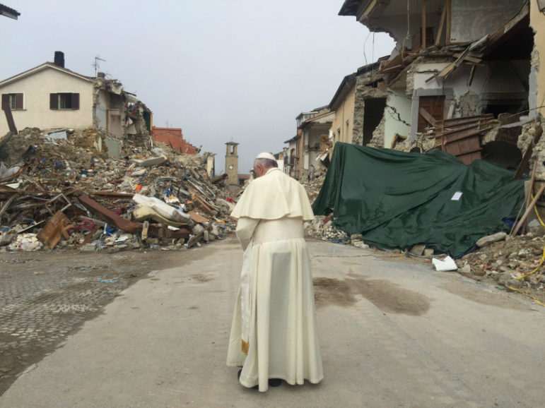 Pope Francis walks through the ruins of Amatrice in Tuesday, Oct. 4, 2016. The Italian town north of Rome was devastated in August by an earthquake that left nearly 300 dead. Photo via the Vatican Press Office.