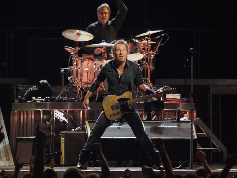 Bruce Springsteen (with Max Weinberg in background on drums) in concert on Aug. 15, 2008. Photo courtesy of Craig ONeal via Creative Commons