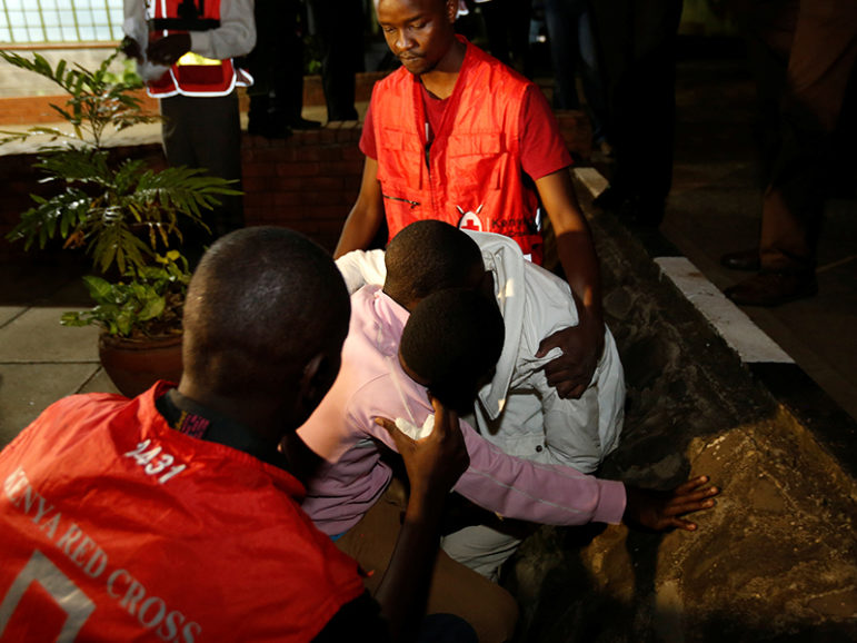 Kenya Red Cross staff console relatives of the civilians killed following an attack at the Bisharo lodging by Islamist militants from the Somali group al Shabaab in Mandera, at the Chiromo mortuary in Kenya's capital Nairobi, on October 25, 2016. Photo courtesy of Reuters/Thomas Mukoya *Editors: This photo may only be republished with ALSHABAB-KENYA, originally transmitted on Oct. 26, 2016.