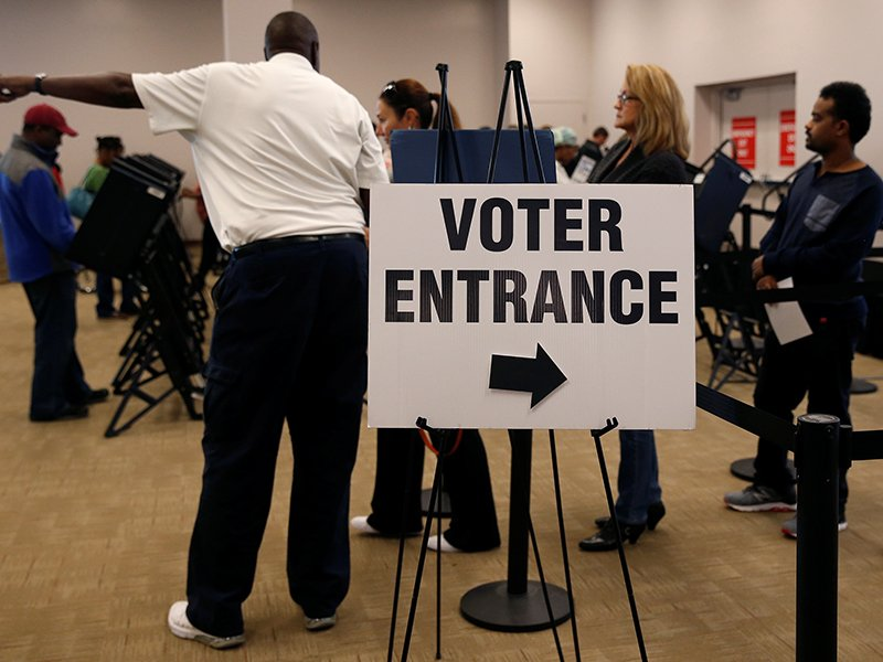 Voters wait in line to cast their ballots during early voting at the Franklin County Board of Elections in Columbus, in Columbus, Ohio on October 28, 2016. Photo courtesy of Reuters/Shannon Stapleton *Editors: This photo may only be republished with RNS-CATHOLIC-VOTE, originally transmitted on Oct. 31, 2016.