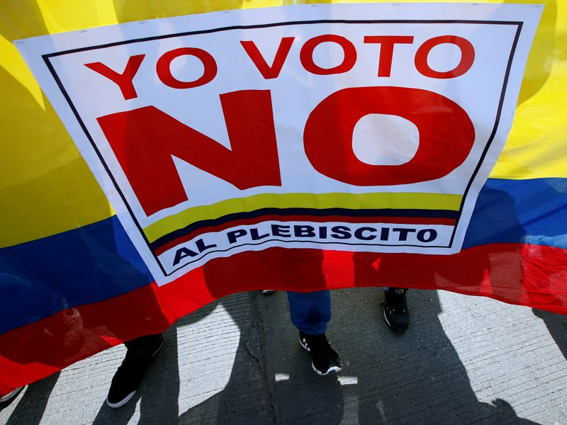 "Demonstrators shout ""I vote NO to the plebiscite"" to protest the government's peace agreement with the Revolutionary Armed Forces of Colombia (FARC) in Cartagena, Colombia on September 26, 2016. Photo courtesy of Reuters/John Vizcaino *Editors: This photo may only be republished with RNS-CHESNUT-OPED, originally transmitted on October 11, 2016."