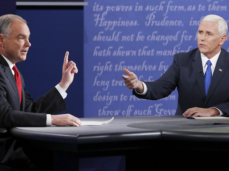Democratic U.S. vice presidential nominee Senator Tim Kaine, left, and Republican U.S. vice presidential nominee Governor Mike Pence debate during their vice presidential debate at Longwood University in Farmville, Virginia, on October 4, 2016. Photo courtesy of Reuters/Jonathan Ernst