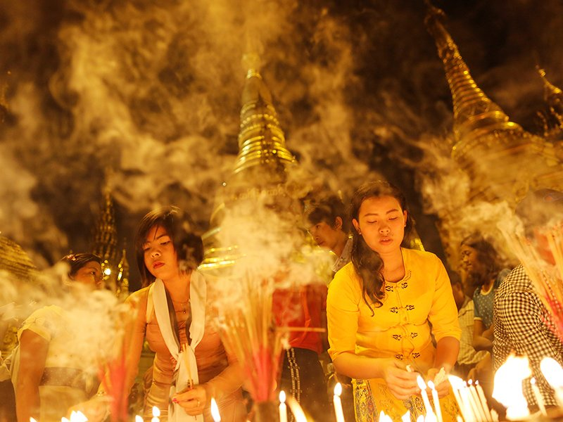 Women light incense for prayers during the Thadingyut (Festival of Lights) full moon day festival at the Shwedagon pagoda in Yangon on October 16, 2016. Photo courtesy of Reuters/Soe Zeya Tun