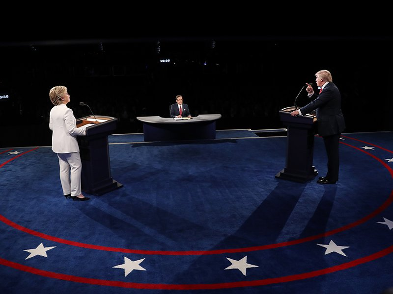 Republican U.S. presidential nominee Donald Trump speaks as Democratic U.S. presidential nominee Hillary Clinton listens during their third and final 2016 presidential campaign debate at UNLV in Las Vegas, on October 19, 2016. Photo courtesy of Reuters/Joe Raedle/Pool