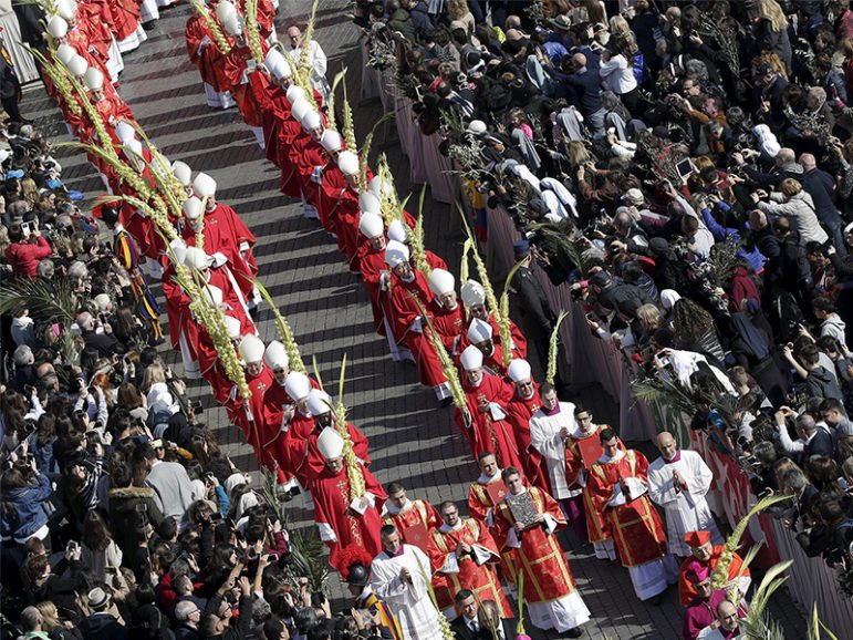 Cardinals hold palm branches at the start of the Palm Sunday mass led by Pope Francis at Saint Peter's Square at the Vatican on March 20, 2016. Photo courtesy of REUTERS/Max Rossi