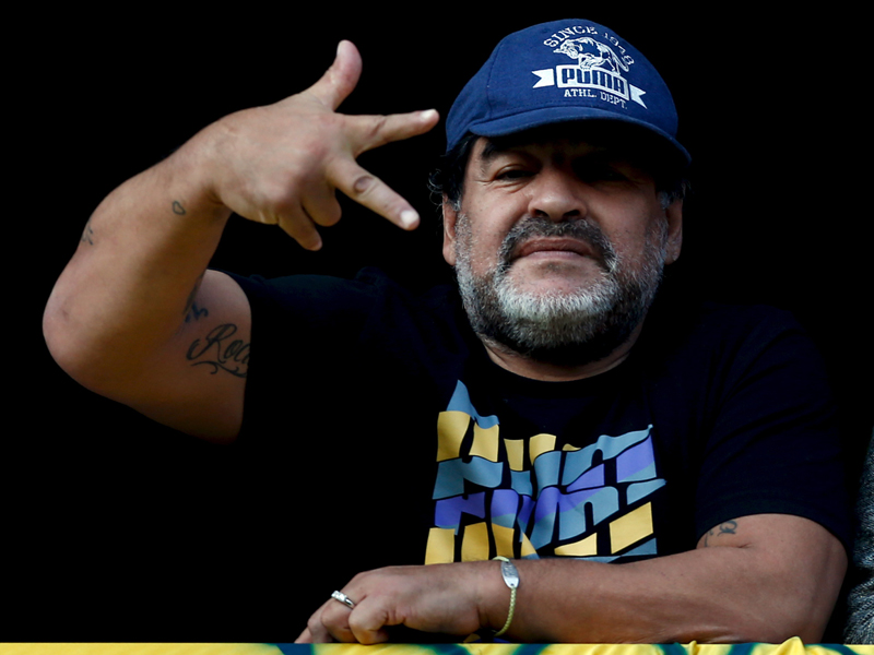 Former Argentine soccer player Diego Maradona gestures from a balcony as he attends the Argentine First Division soccer match between Boca Juniors and Quilmes at La Bombonera stadium in Buenos Aires on July 18, 2015. Photo courtesy of Reuters/Marcos Brindicci *Editors: This photo may only be republished with RNS-POPE-MARADONA, originally transmitted on October 11, 2016.