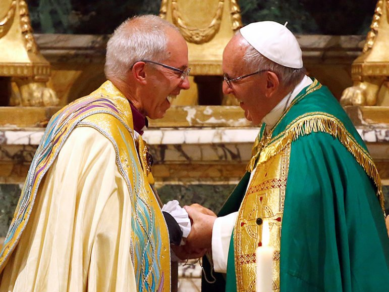 Pope Francis smiles with Archbishop of Canterbury Justin Welby at the end of vespers prayers at the monastery church of San Gregorio al Celio in Rome, on October 5, 2016. Photo courtesy of Reuters/Tony Gentile