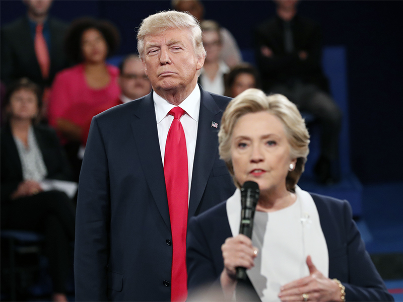 364c562fc6 Republican presidential nominee Donald Trump listens as Democratic nominee Hillary  Clinton answers a question from the audience during their presidential ...