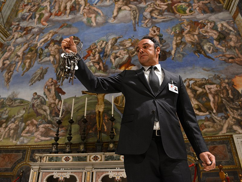 Gianni Crea, chief key-keeper at the Vatican, in the Sistine chapel with the bunch of keys he uses to access all rooms in the museum, on October 6, 2016. Photograph by Chris Warde-Jones