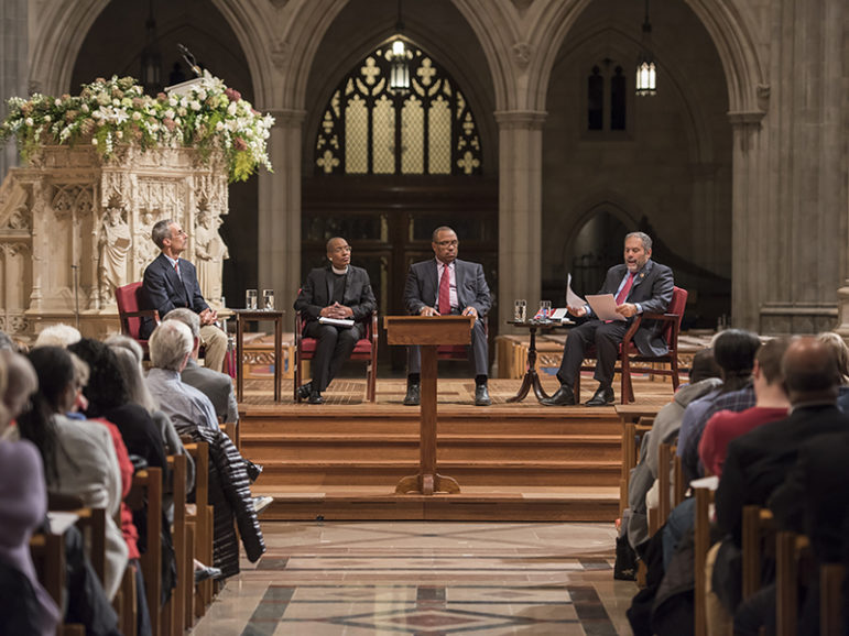 Washington National Cathedral held a discussion on its windows honoring Confederate generals on Oct. 26, 2016. Speakers, from left to right, are Civil War scholar John Coski, the Rev. Kelly Brown Douglas of the cathedral, Rex Ellis of the National Museum of African American History and Culture and moderator Ray Suarez. Photo courtesy of Danielle Thomas/Washington National Cathedral
