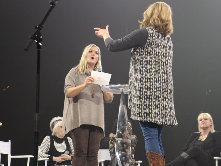 Bestselling authors and speakers Shauna Niequist, left, and Jen Hatmaker, kick off the Belong Tour stop at the Xcel Energy Center with a lightning round of questions on Oct. 21, 2016, in St. Paul, Minn. RNS photo by Emily McFarlan Miller