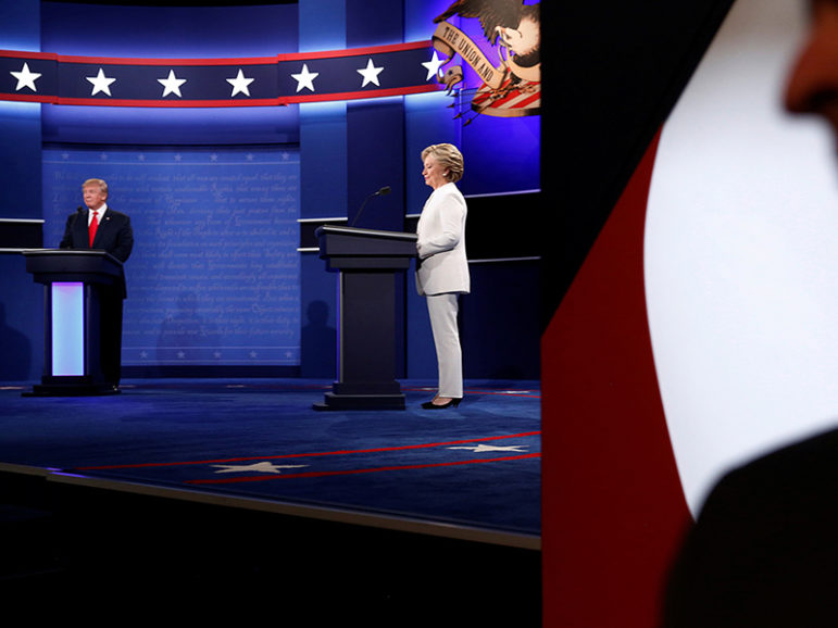 A Secret Service agent stands near the stage as Republican U.S. presidential nominee Donald Trump, left, and Democratic U.S. presidential nominee Hillary Clinton, center, begin their third and final 2016 presidential campaign debate at UNLV in Las Vegas, on October 19, 2016. Photo courtesy of Reuters/Jonathan Ernst