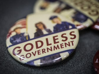 "Free bottons that read ""Godless Government,"" are offered during a gathering with the Kansas City Atheist Coalition and the Satanic Temple to discuss religious freedom on September 30, 2016 in Kansas City, Mo. RNS photo by Sally Morrow"