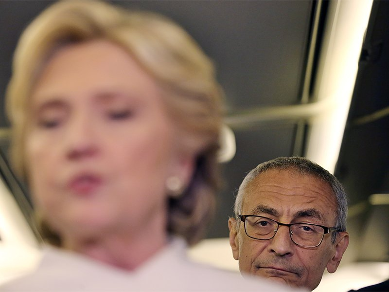 John Podesta, chairman of U.S. Democrat Hillary Clinton's presidential campaign, listens as she talks to the media inside of her campaign plane after the third and final 2016 presidential campaign debate in North Las Vegas, Nevada, on October 19, 2016. Photo courtesy of REUTERS/Carlos Barria. *Editors: This photo may only be republished with RNS-CAFARDI-OPED, originally transmitted on Oct. 28, 2016.