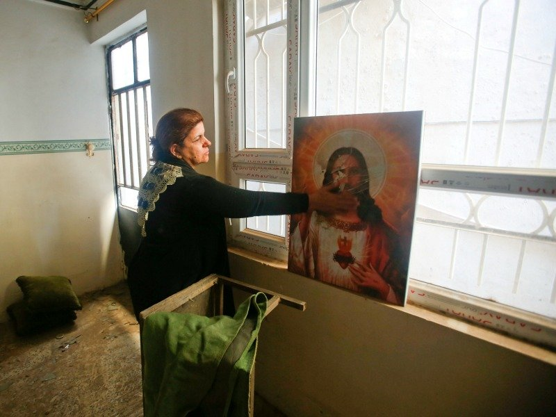 A Christian woman inspects a home