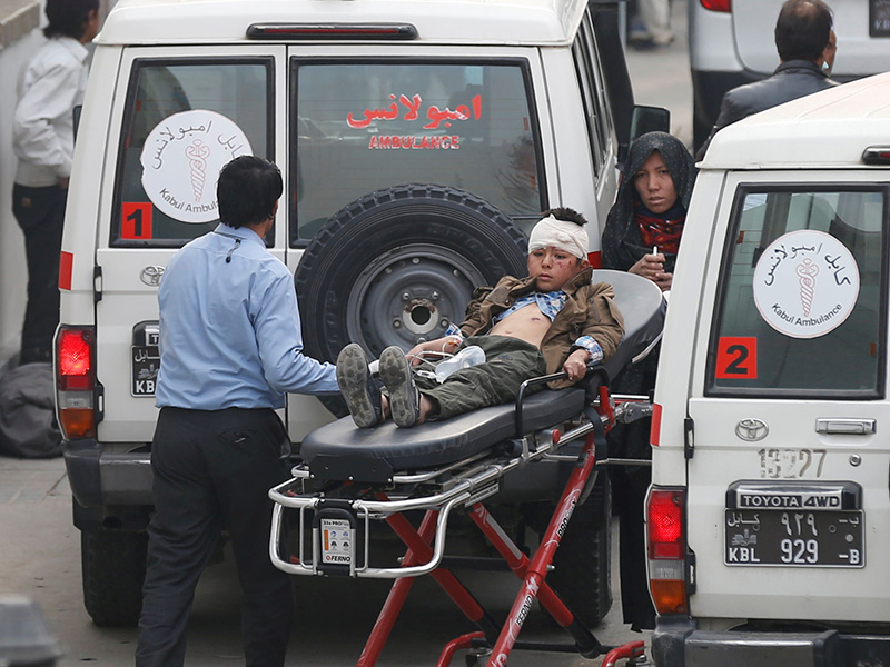 An injured boy is transported to a hospital after a suicide attack in Kabul, Afghanistan