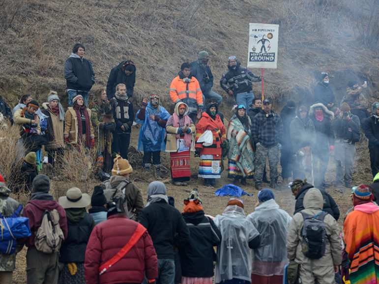 Protesters participate in a prayer circle on Turtle Island on Thanksgiving day during a protest against plans to pass the Dakota Access pipeline near the Standing Rock Indian Reservation, near Cannon Ball, North Dakota, U.S. November 24, 2016. Photo courtesy of REUTERS/Stephanie Keith *Editors: This photo may only be republished with RNS-DAKOTA-SPIRITUALITY, transmitted on Nov. 23, 2016.