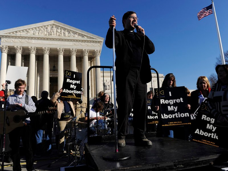 Rev. Frank Pavone, National Director of Priests for Life, leads a prayer during the March for Life anti-abortion rally in front of the US Supreme Court building in Washington, on January 22, 2009. Photo courtesy of REUTERS/Jonathan Ernst