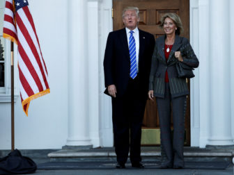 U.S. President-elect Donald Trump stands with Betsy DeVos after their meeting at the main clubhouse at Trump National Golf Club in Bedminster, New Jersey, on November 19, 2016. Photo courtesy of Reuters/Mike Segar