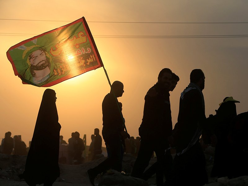 Shi'ite Muslim pilgrims walk to the holy city of Kerbala, ahead of the holy Shi'ite ritual of Arbaeen, in Najaf, on November 19, 2016. Photo courtesy of Reuters/Alaa Al-Marjani *Editors: This photo may only be republished with RNS-ARBAEEN-IRAQ, originally transmitted on Nov. 21, 2016.