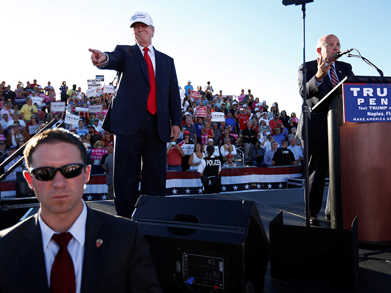 Former New York mayor Rudy Giuliani, right, says a few words of support for Republican U.S. presidential nominee Donald Trump, left, during a campaign rally in Naples, Florida, on October 23, 2016. Photo courtesy of Reuters/Jonathan Ernst *Editors: This photo may only be republished with RNS-AUGUSTINE-ELECTION, originally transmitted on Nov. 3, 2016.
