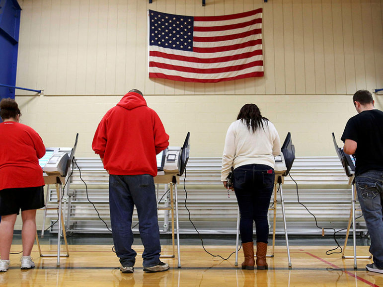 Voters cast their votes during the presidential election in Elyria, Ohio, on Nov. 8, 2016. Photo courtesy of Reuters/Aaron Josefczyk/File Photo *Editors: This photo may only be republished with RNS-RELIGION-VOTE, originally transmitted on Nov. 9, 2016.