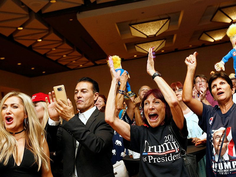 Donald Trump supporters cheer as U.S. presidential election results are announced during a Republican watch party in Phoenix, Arizona, on November 8, 2016. Photo courtesy of Reuters/Nancy Wiechec