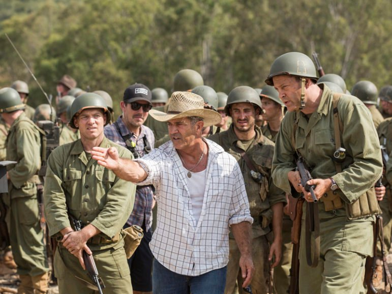 Left to right, Sam Worthington, director Mel Gibson and Vince Vaughn on the set of