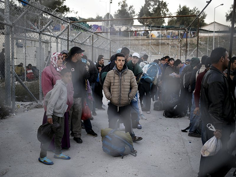 Refugees and migrants wait to be registered at the Moria refugee camp on the Greek island of Lesbos, on November 5, 2015. Photo courtesy of Reuters/Alkis Konstantinidis/File Photo